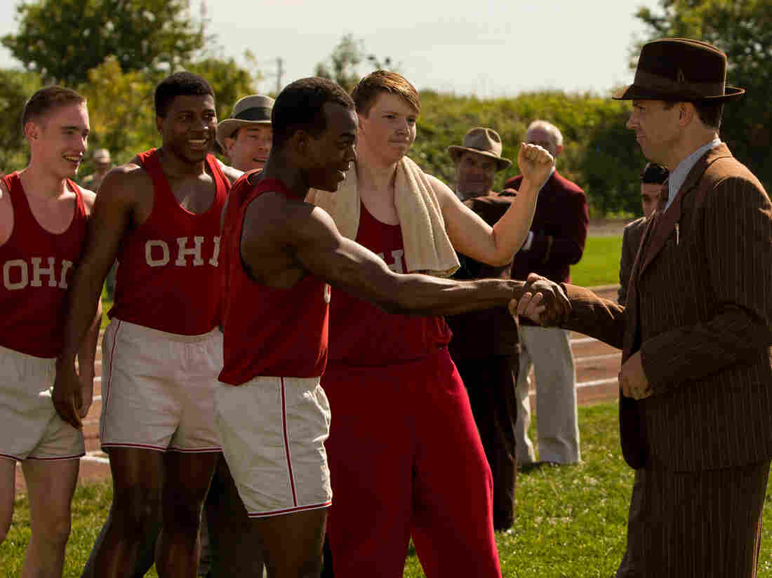 Stephan James (center) stars as Jesse Owens and Jason Sudeikis (right) stars as Larry Snyder in Stephen Hopkins' Race.