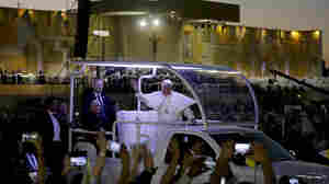 Pope Francis waves from his popemobile in Juarez, Mexico, where he celebrated an outdoor Mass on Wednesday.