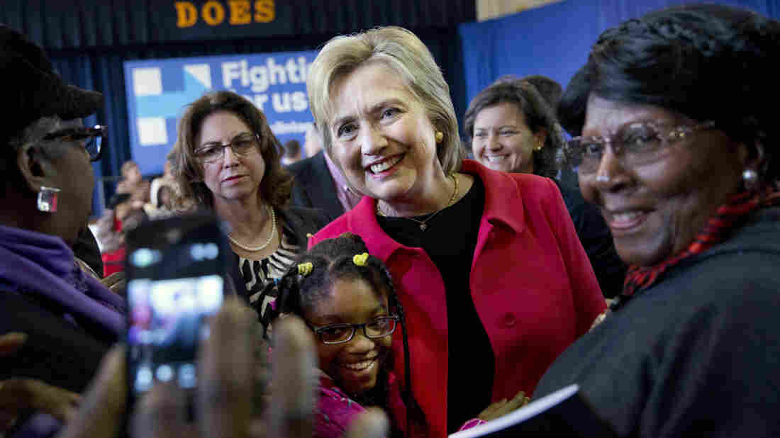 Hillary Clinton takes a photograph with Jordan Daniels, 11, of Denmark, S.C., during a town hall Friday.