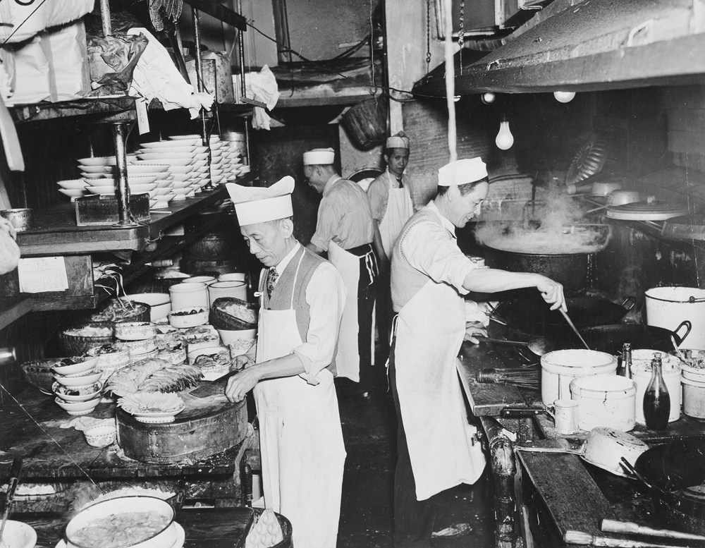 Chefs at work in the kitchen of a restaurant in New York's Chinatown, circa 1940. For many Chinese, opening up restaurants became a way to bypass U.S. immigration laws designed to keep them out of the country.