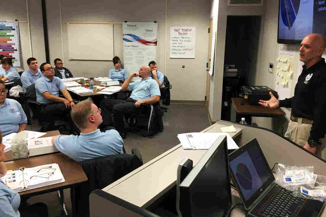 An instructor conducts a training session at Transportation Security Administration Academy at the Federal Law Enforcement Training Center, located at a sprawling former air base in Glynco, Ga.