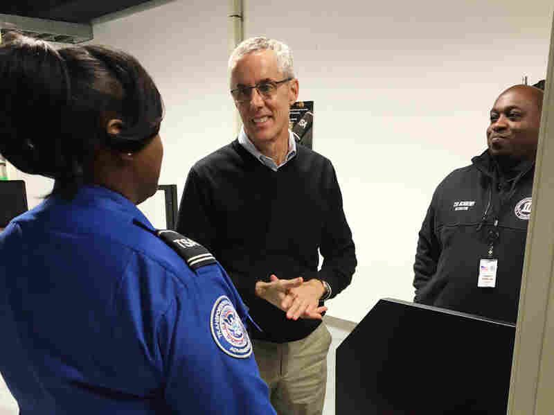 TSA Administrator Peter Neffenger (center) speaks with two academy instructors.
