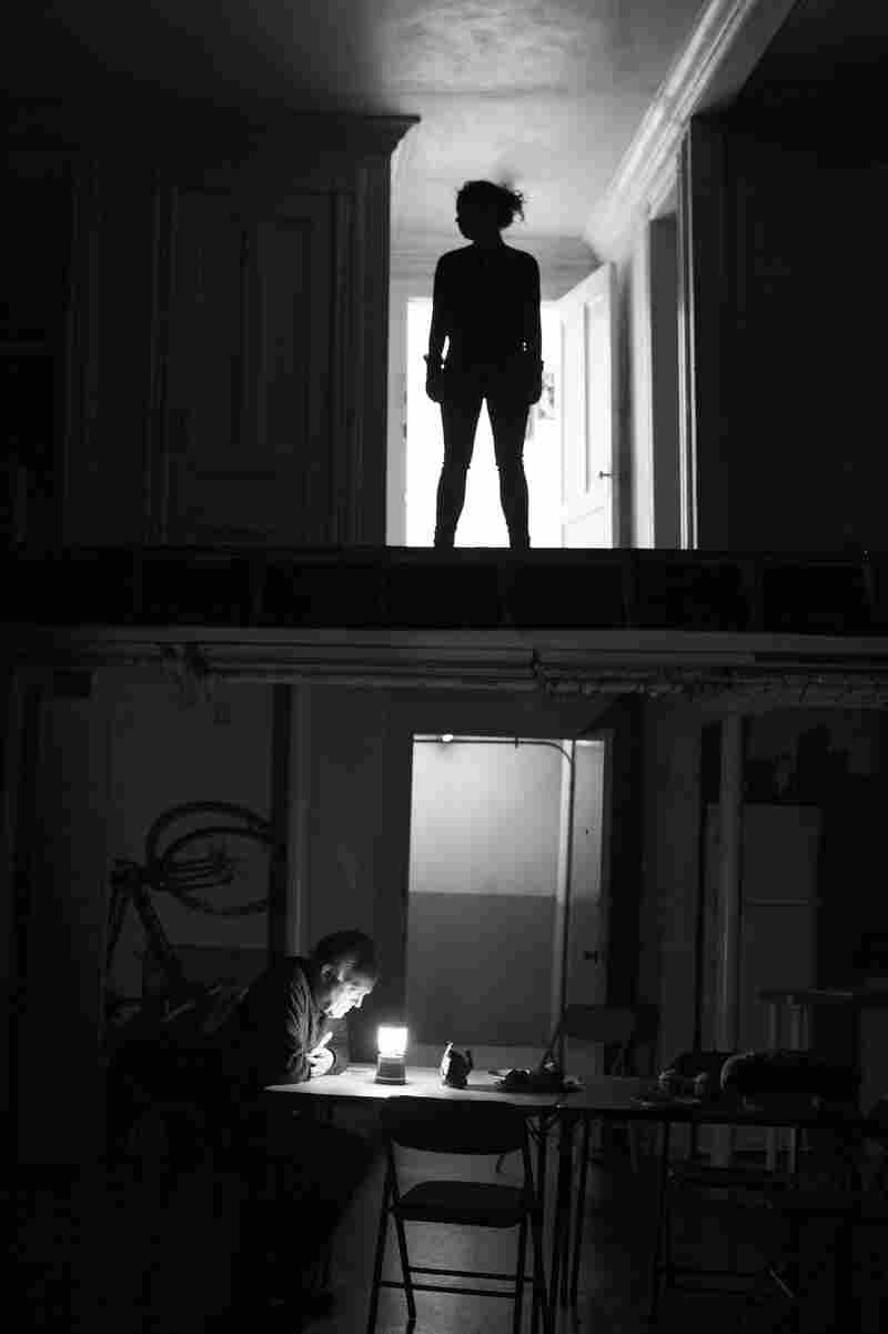 Even the play's set evokes fear, with weird noises and shadows, and the lights go out one by one. (Pictured: Sarah Steele, Reed Birney)