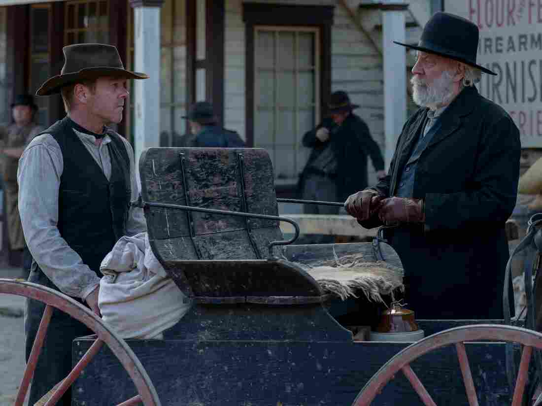 Kiefer Sutherland (left) as John Henry Clayton and Donald Sutherland (right) as Reverend William Clayton in the western Forsaken.