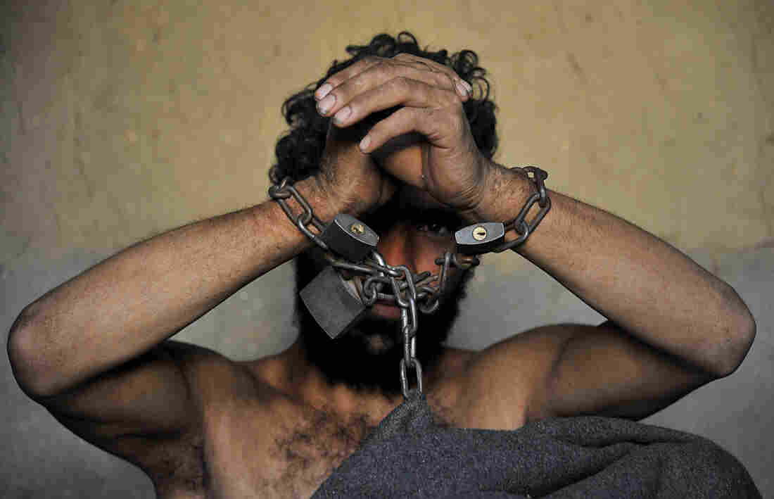 A mentally ill patient in Afghanistan at the Mia Ali Baba holy shrine in the village of Samar Khel. The mentally ill are thought to be possessed by demons and so are chained for 40 days.