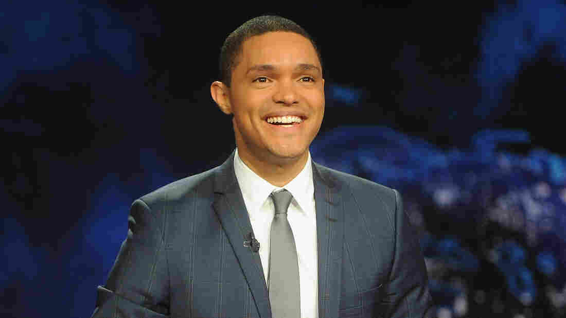 """Trevor Noah — who took over hosting from Jon Stewart in 2015 — remembers watching The Daily Show on CNN in South Africa. """"It looked like a news show and it had the same colors as CNN and the ticker,"""" he says. """"I just worked under the assumption that it was part of the news programming. ... I thought that Jon Stewart was a news anchor who didn't take his job seriously."""""""