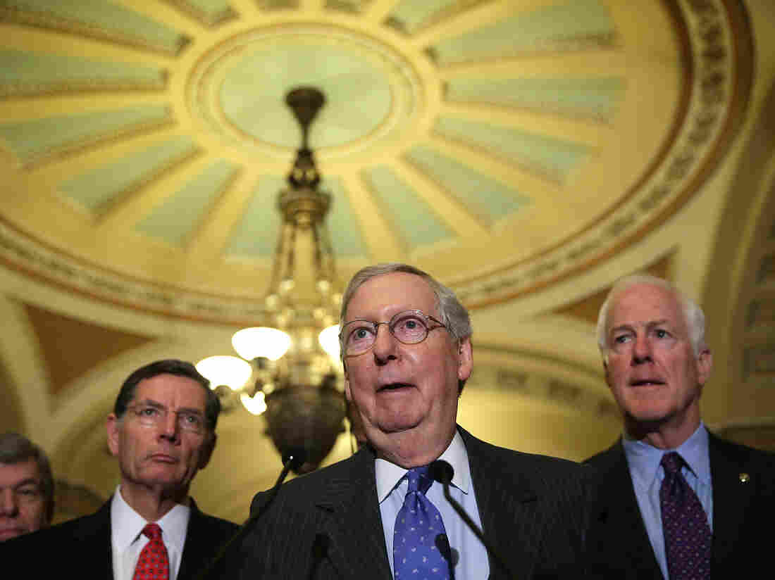 Senate Majority Leader Mitch McConnell (center), R-Ky., speaks to members of the media as fellow Republican Sen. John Barrasso of Wyoming (left) and Senate Majority Whip John Cornyn of Texas (right) listen after the Republican weekly policy luncheon on Jan. 20.