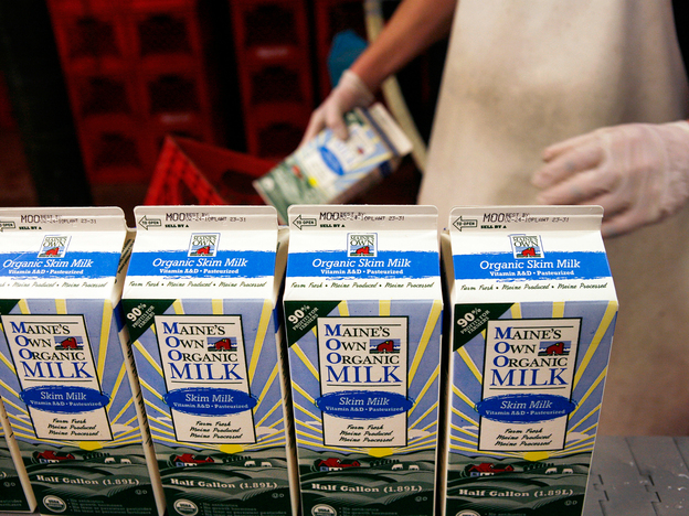 Organic milk is processed at a dairy farm in Westbrook, Maine. A new meta-analysis finds that organic milk contains significantly more omega-3 fatty acids than its conventional counterpart.