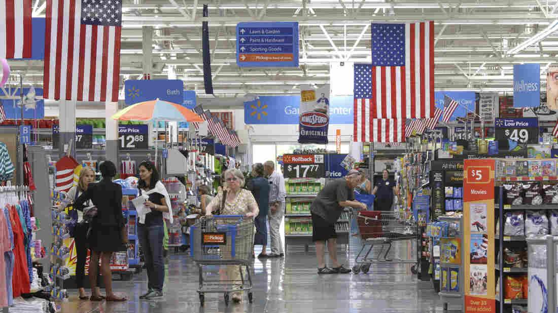 Customers shop at a Wal-Mart Supercenter store in Springdale, Ark., last summer.