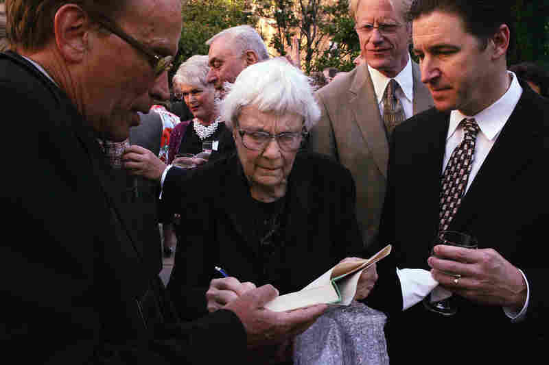 Lee (center) attends a Los Angeles Public Library Awards Dinner in her honor at The Richard J. Riordan Central Library Maguire Gardens in 2005.