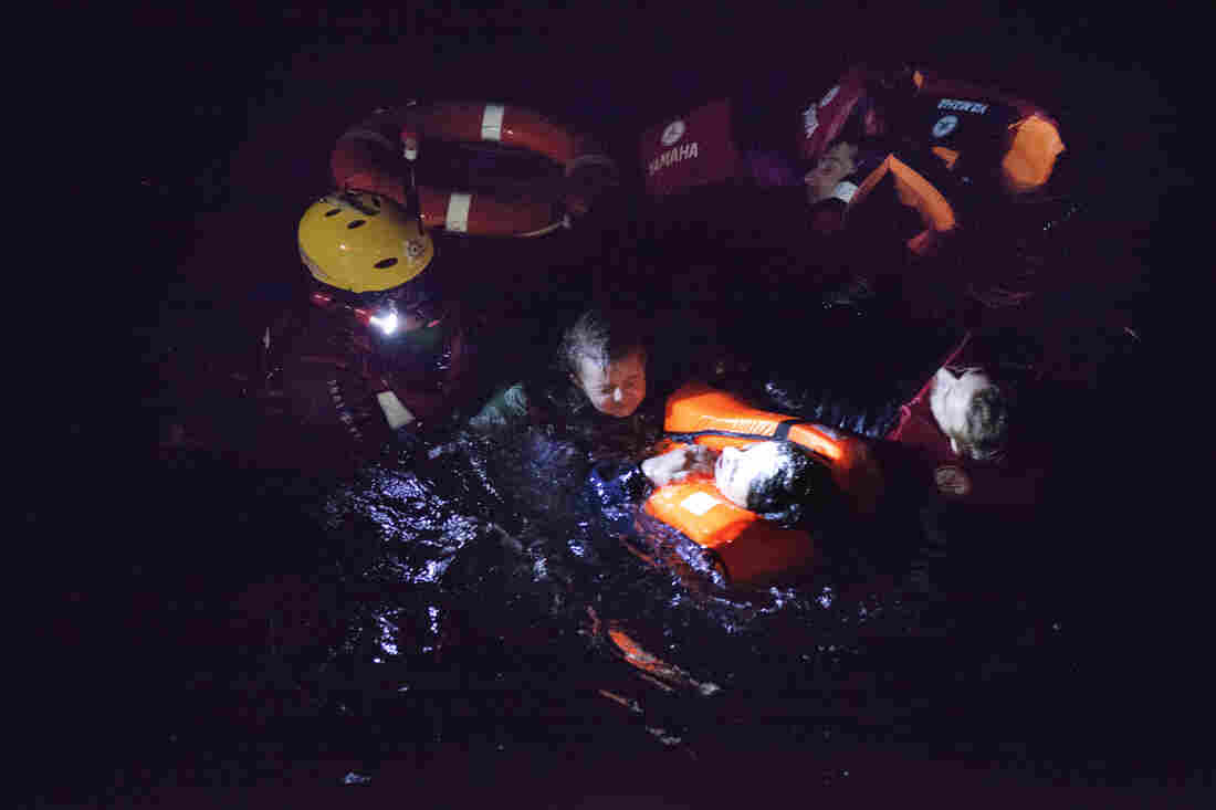 On the night of Jan. 15, rescue swimmers tried to bring children out of the water to safety first.