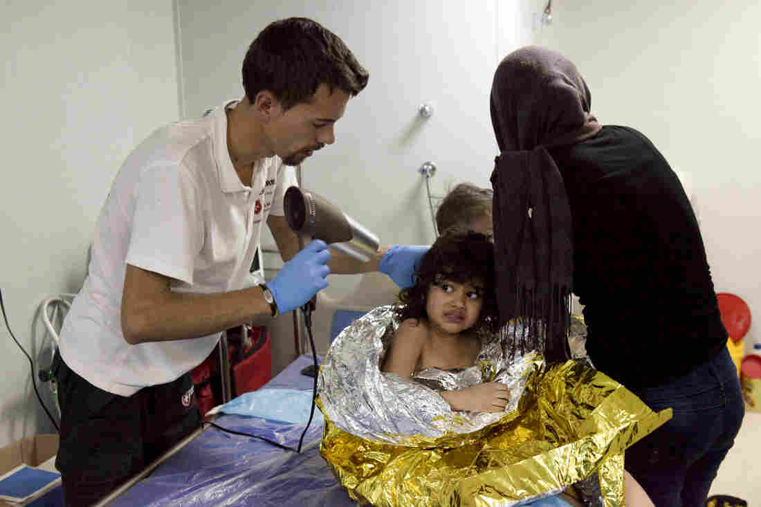 Italian medic Roberto Pantaleo, 26, warmed up children rescued after their boat capsized in the Aegean on Jan. 15.