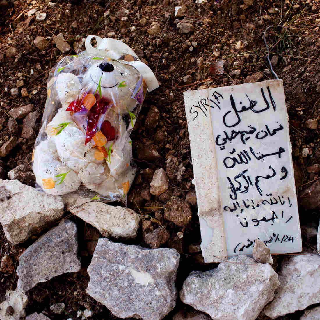 "At a makeshift burial ground in Samos, beyond the edges of a Greek Orthodox cemetery, lie the bodies of three Syrian children. The marker reads, ""The child Noaman Tamim Shibly — For us Allah suffices, and he is the best disposer of affairs. To God we belong, and to him we shall return."""