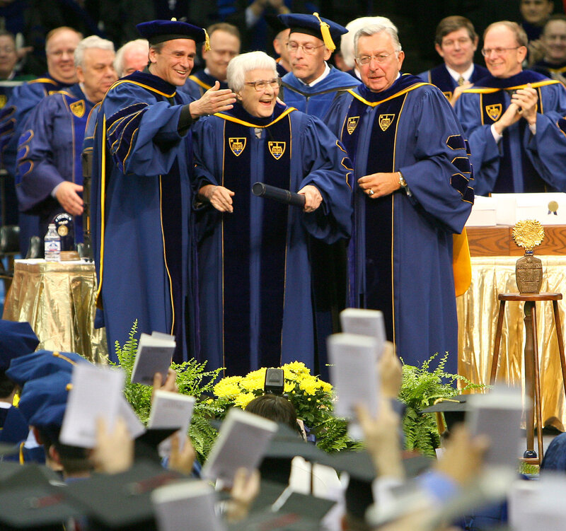 Lee and University of Notre Dame officials look out at the graduates of the class of 2006 as they hold up copies of To Kill a Mockingbird during commencement ceremonies. Notre Dame awarded Lee an honorary degree. (Matt Cashore/AP)