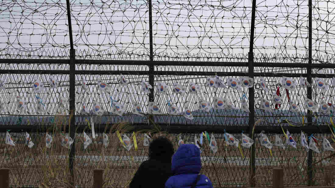 Visitors look at the military wire fences at the Imjingak Pavilion near the border village of Panmunjom, which has separated the two Koreas since the Korean War, in Paju, South Korea, on Feb. 14.