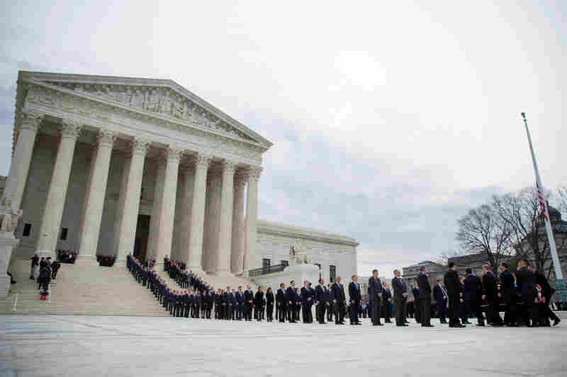 Supreme Court police officers serving as pallbearers carried the casket, and some of Justice Scalia's former law clerks acted as honorary pallbearers.