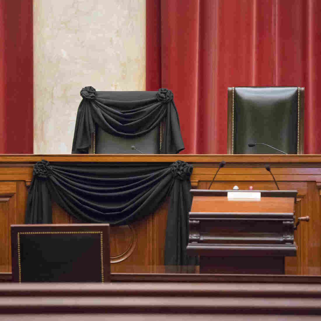 Supreme Court Justice Antonin Scalia's courtroom chair is draped in black to mark his death in a tradition that dates to the 19th century.
