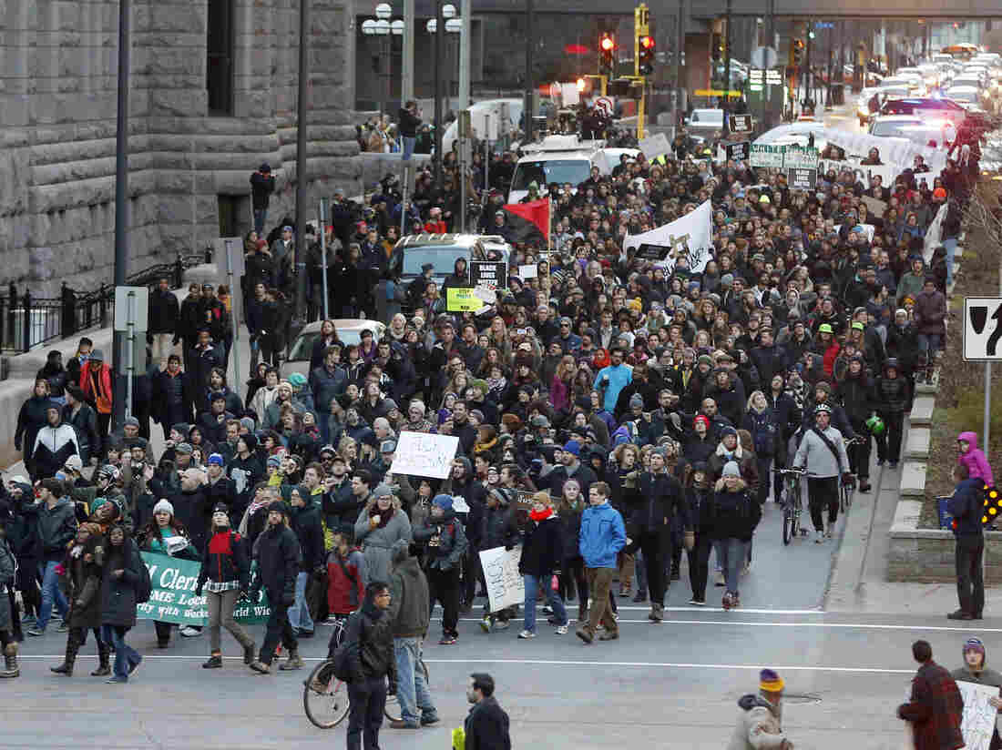 Black Lives Matter demonstrators and supporters march through downtown Minneapolis, Tuesday, Nov. 24, 2015, to the Federal Building.  One of our reads this week casts light on the mental health issues facing activists.