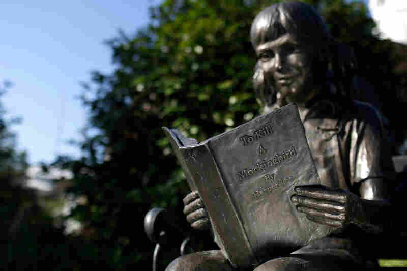 A statue of a young girl reading To Kill a Mockingbird in Lee's hometown of Monroeville, Ala.