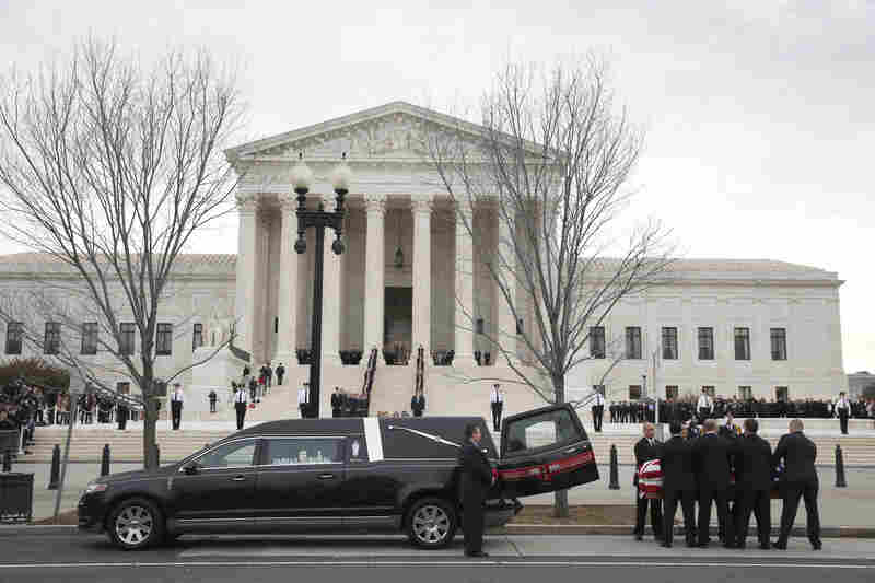 The body of Justice Antonin Scalia arrives Friday at the Supreme Court in Washington, D.C., where mourners will pay their respects in the Great Hall.