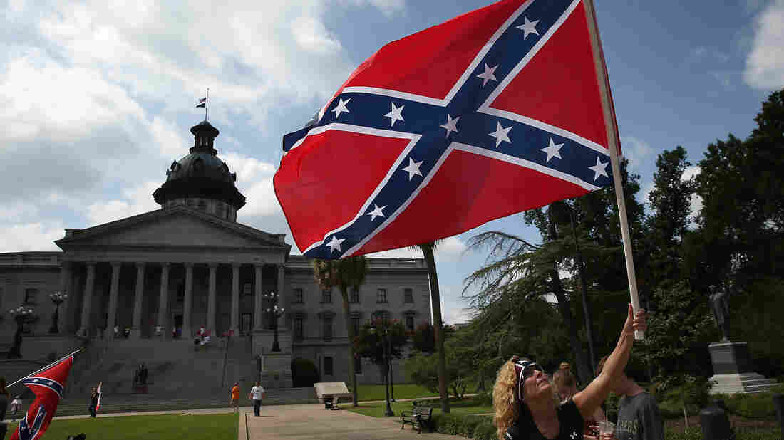Barbie Byrd, of Columbia, S.C., joins a group of demonstrators on the grounds of the South Carolina State House calling for the Confederate battle flag to remain on the Capitol grounds in June 2015.