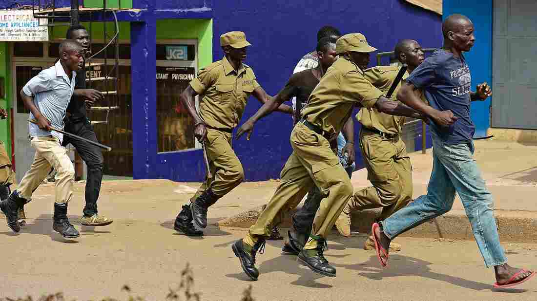 Police in Uganda arrest suspected protesters after they demonstrate their support for opposition leader Kizza Besigye.
