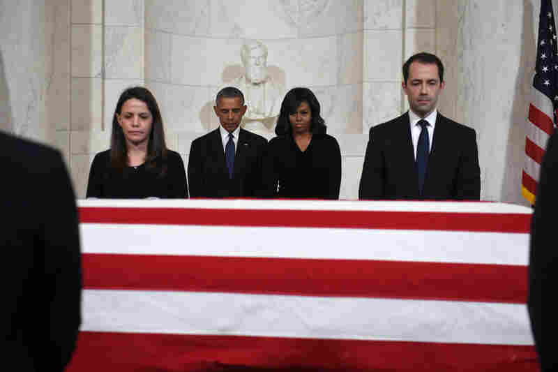 President Obama and first lady Michelle Obama pay their respects as Supreme Court Justice Antonin Scalia's body lies in repose at the Supreme Court.
