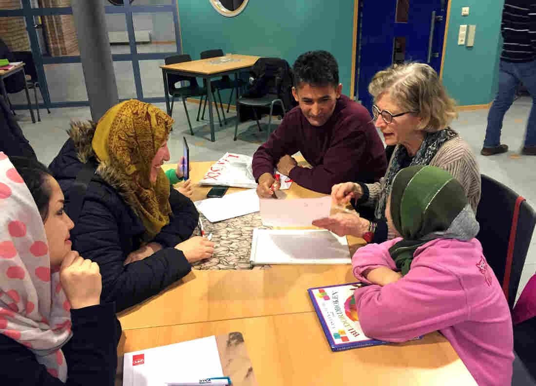 Swedish volunteer Mia Gustafsson, 77, helps families from Afghanistan learn Swedish.