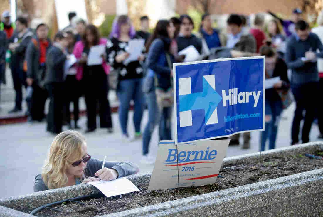 Kara Bonham registers to vote for the Democratic caucus at the University of Nevada on Saturday in Reno, Nev.