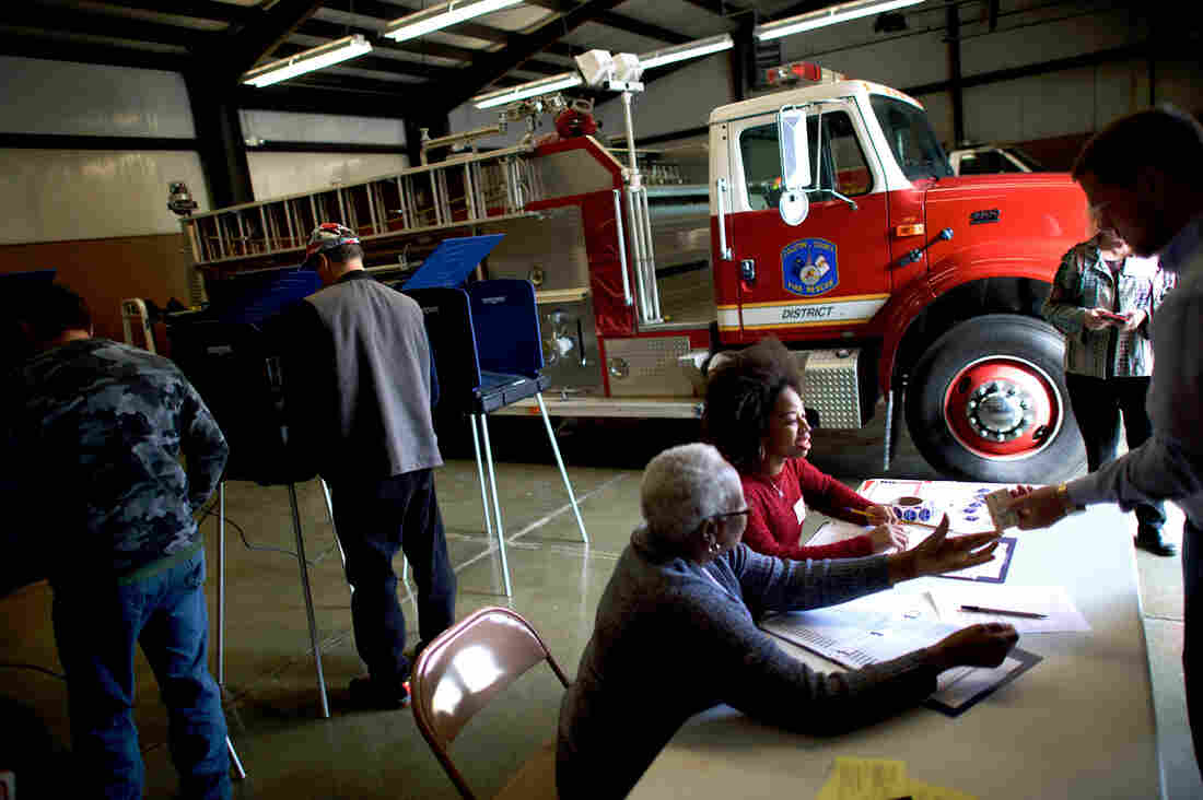 Erica Levine, 20, a poll manager at the Colleton County Fire & Rescue polling precinct registers a voter in Walterboro, S.C.