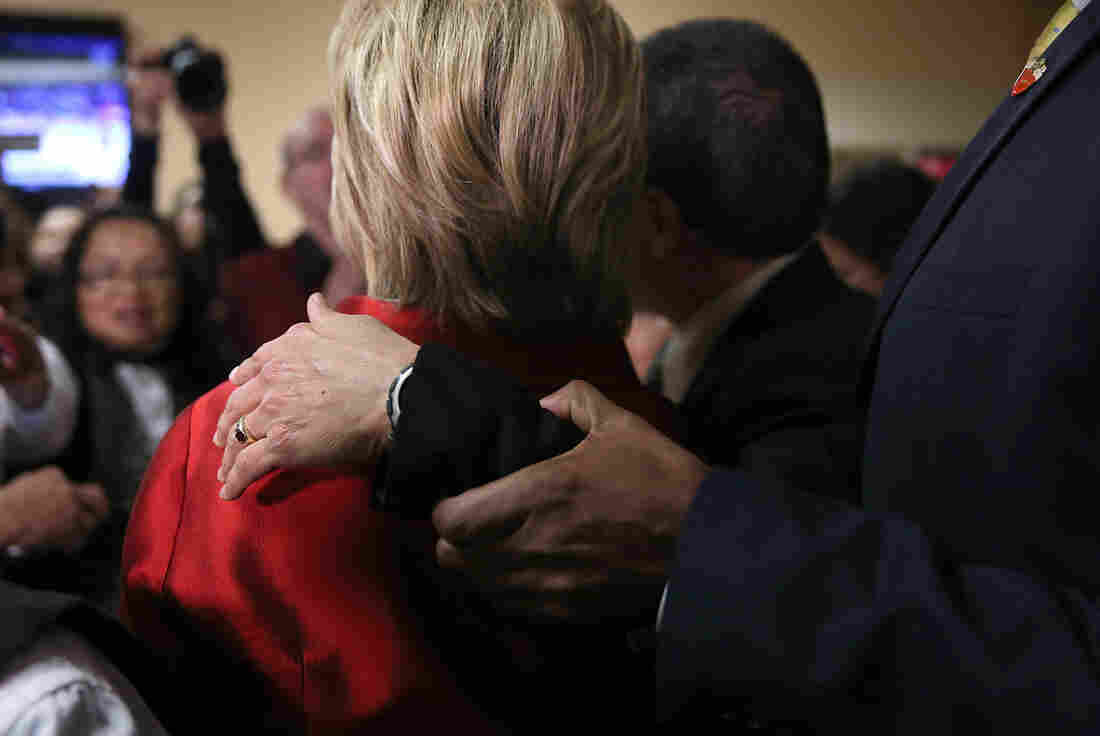 A U.S. Secret Service agent pulls a man's arm from the shoulder of Democratic presidential candidate Hillary Clinton as she greets workers inside the employee dining room at Harrah's Las Vegas. Clinton met with casino workers at Harrah's before doors opened for the Nevada Democratic caucus.