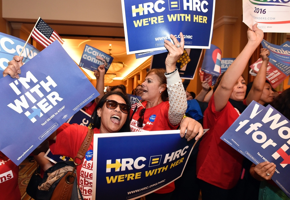 Naomi Barnes (left) shows her support for Democratic presidential candidate Hillary Clinton during the Nevada caucus in Las Vegas. (Josh Edelson/AFP/Getty Images)