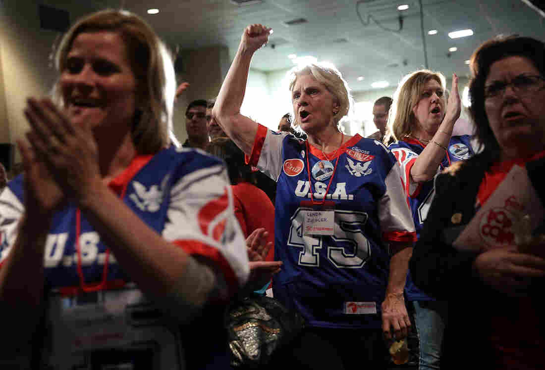 Supporters of Republican presidential candidate Ted Cruz cheer during a primary night party at the South Carolina State Fairgrounds in Columbia, South Carolina.