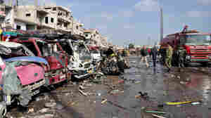 Dozens Killed In Blasts In 2 Syrian Cities; ISIS Claims Responsibility