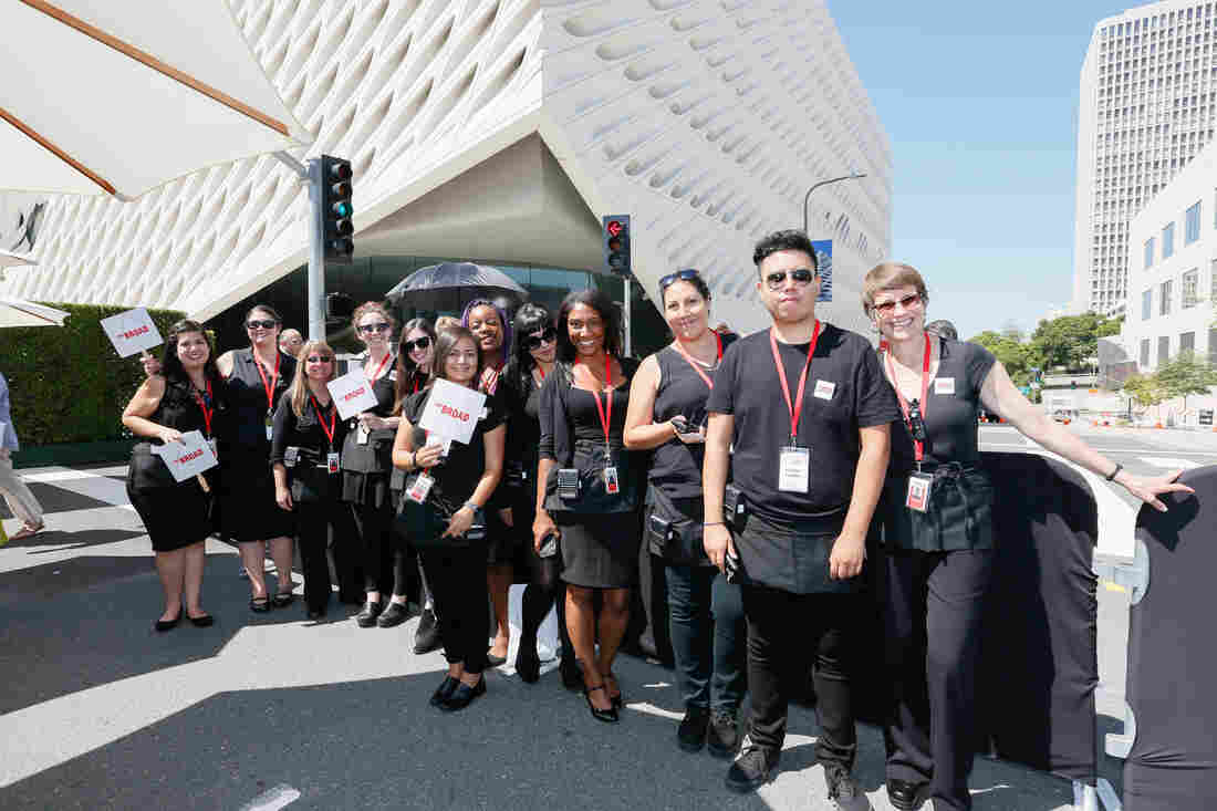 The guards at The Broad Museum in Los Angeles aren't just here to protect the art — they're also expected to engage and educate. They're called visitor services associates, and they've gone through hours and hours of training to become ambassadors for contemporary art.