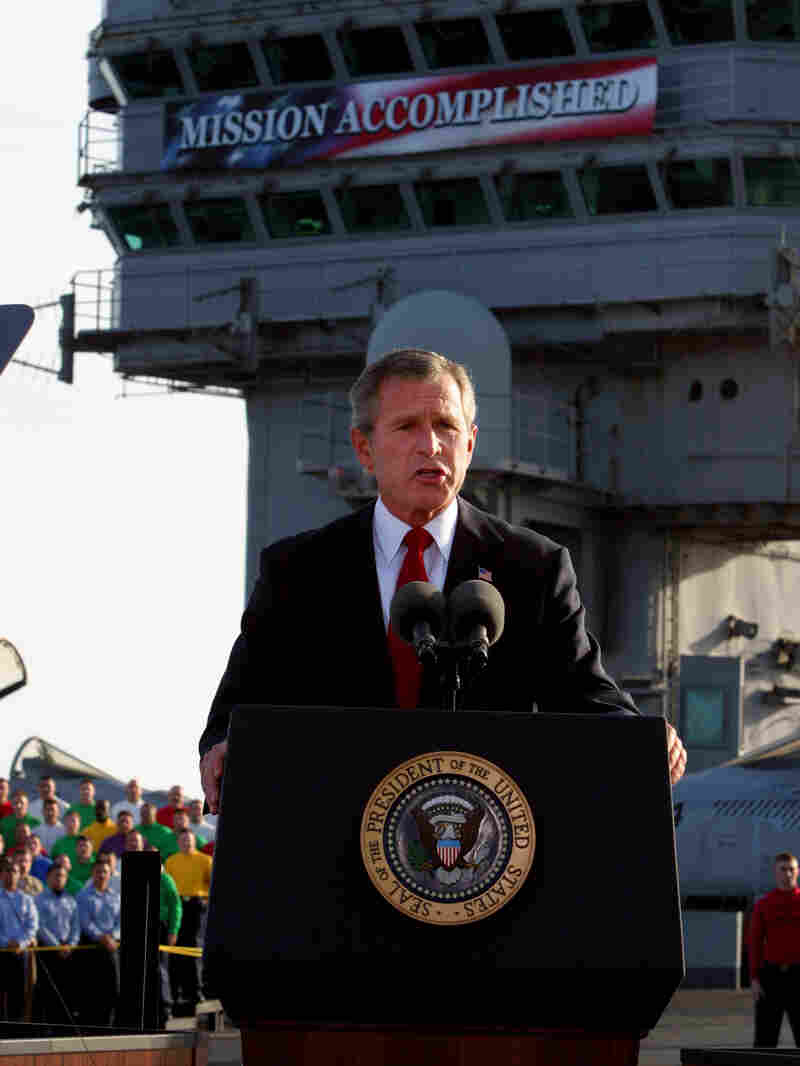 President George W. Bush declares the end of major combat in Iraq aboard the aircraft carrier USS Abraham Lincoln on May 1, 2003. The war in Iraq would drag on for years.