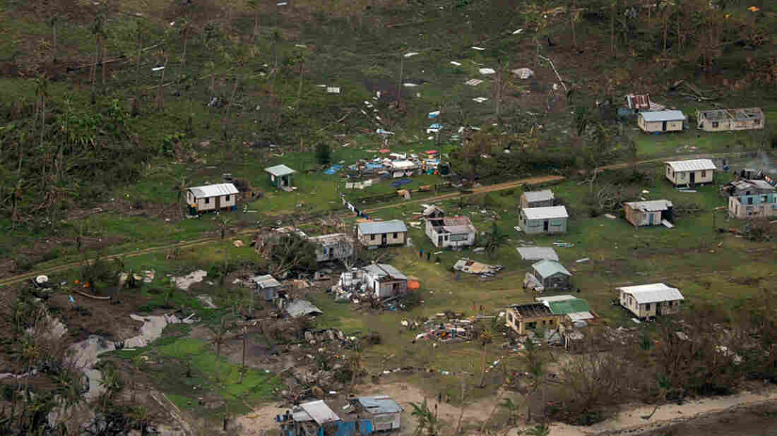 Debris is scattered around damaged buildings at Nakama settlement in Fiji, after Cyclone Winston tore through the island nation.