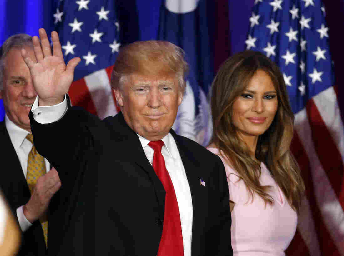 Republican presidential candidate Donald Trump waves with his wife, Melania, during a South Carolina Republican primary night event.