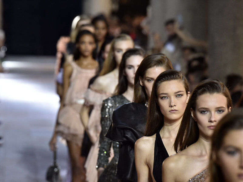 Models walk the runway during the Roberto Cavalli Ready-to-Wear fashion show as part of Milan Fashion Week Spring/Summer 2016 in Milan.
