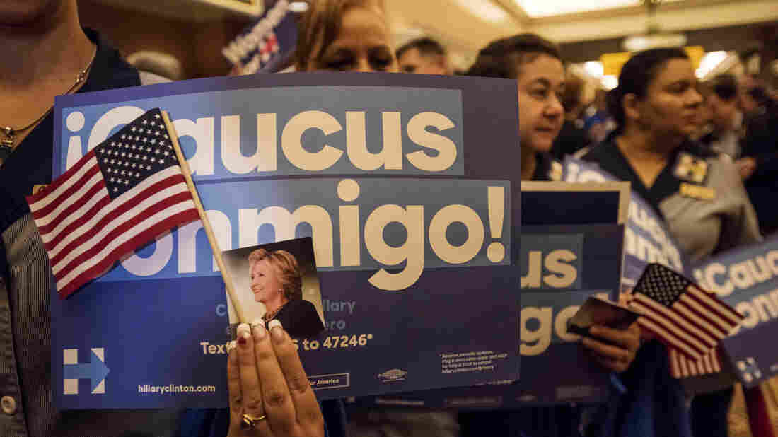 """""""Caucus conmigo"""" (""""Caucus with me"""") signs were a common sight at Clinton events in Nevada."""