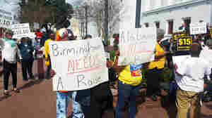 A coalition of clergy, fast-food workers and labor advocates rallied Tuesday in Montgomery, Ala., to defend a bill establishing a minimum wage of $10.10 an hour in the city of Birmingham, Ala.