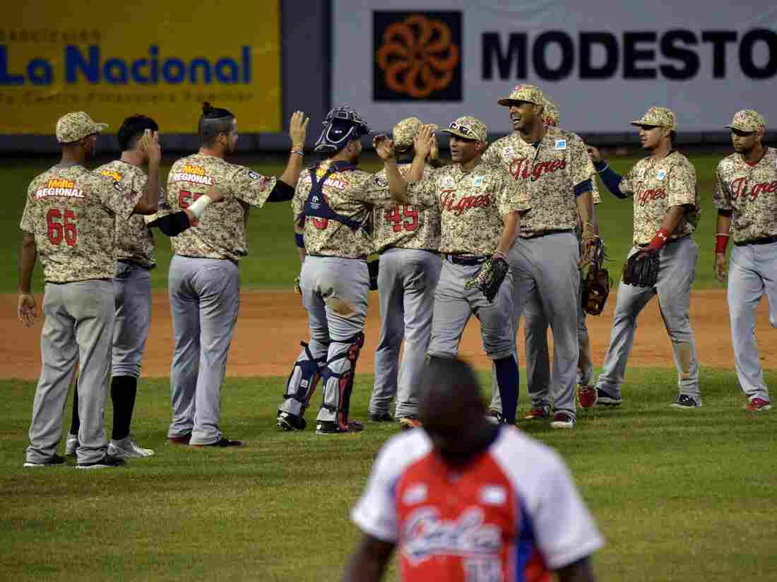 Venezuelan players celebrate after beating Cuba in the Dominican Republic on Feb. 4. More than 20 U.S. major league teams established baseball academies in Venezuela in the 1990s; currently, more than 60 Venezuelans are in the major leagues. But the turmoil in Venezuela has led most U.S. teams to close their academies.