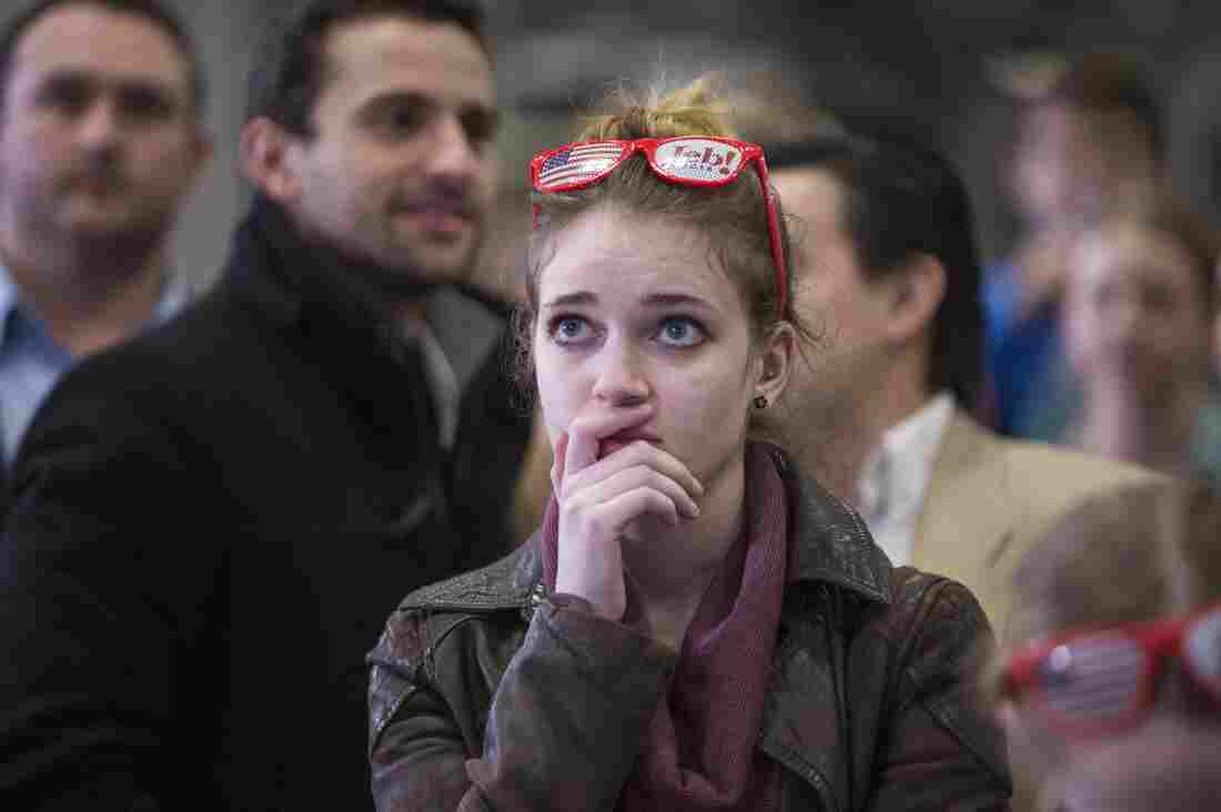 A young woman watches poll numbers at Republican presidential candidate Jeb Bush's election-night party on Feb. 9 in Manchester, N.H. In the last presidential election, millenials had the lowest voter turnout of any age group.