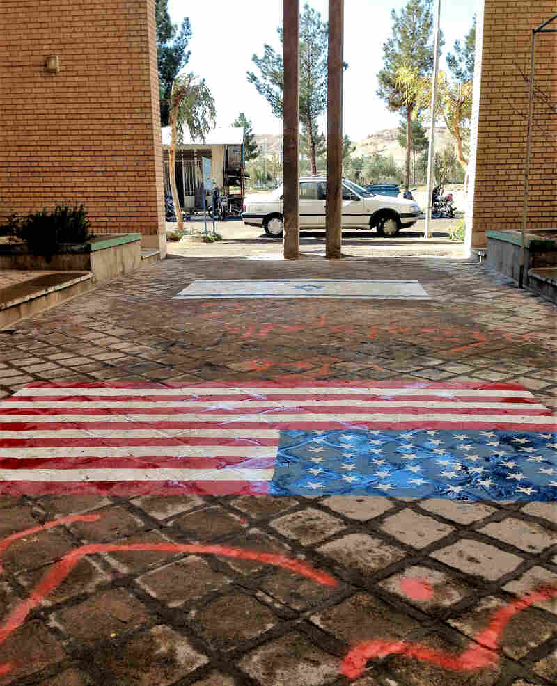 Depictions of the U.S. and Israeli flags are painted on the floor at the entrance to a Qom religious school, so students can step on the images.