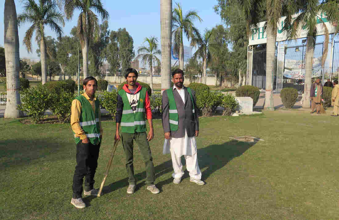 These guards patrol a park in the Pakistani city of Gujranwala to make sure there's no sexual harassment of women. If they have to, they'll deliver a sharp tap to an offender with that stick. From left: Mohammed Sayed, Mohammed Faisal and Amir Hussein.
