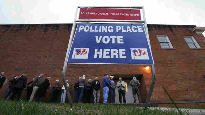 Voters wait in line for a polling place to open at Eastlan Baptist Church last Saturday in Greenville, S.C.