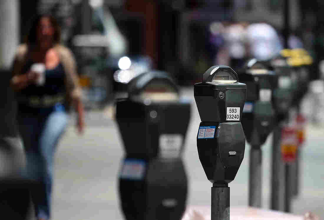 A row of parking meters lines O'Farrell Street in San Francisco. The city issues 1.5 million tickets a year.