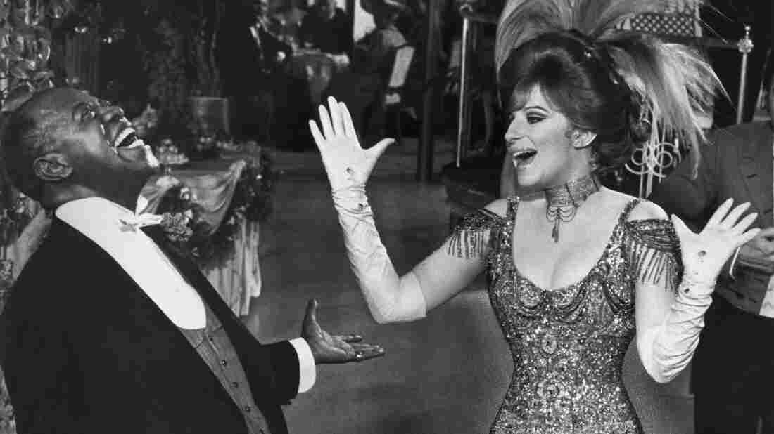 Louis Armstrong and Barbra Streisand have a laugh on the set of Hello, Dolly! The 1969 musical comedy won an Oscar for its score, co-composed by Lionel Newman.