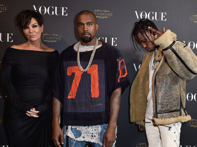 Kris Jenner, Kayne West and Travis Scott at the Vogue 95th Anniversary Party in October of 2015 in Paris. (Pascal Le Segretain/Getty Images for Vogue)
