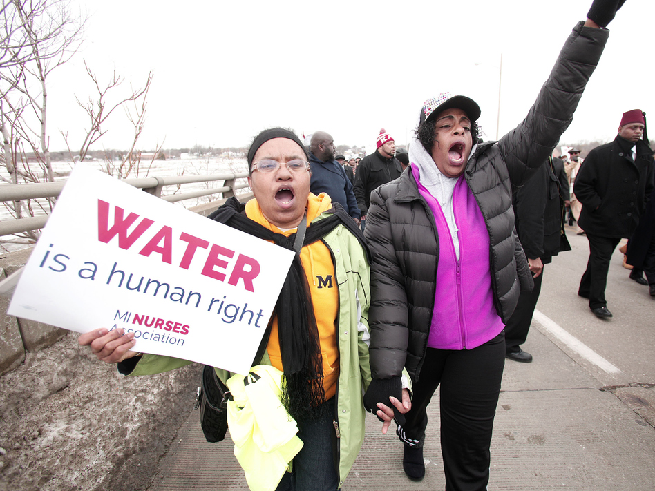 People participate in a national mile-long march in February to highlight the push for clean water in Flint, Mich. (Bill Pugliano/Getty Images)